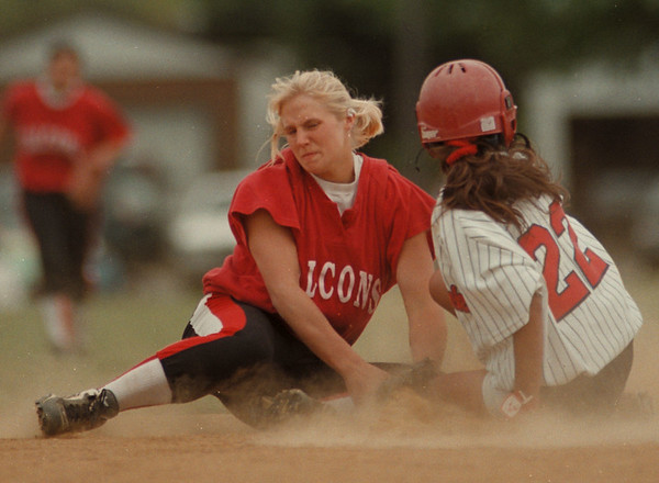 98/05/21--Softball 2--Takaaki Iwabu photo-- Niagara Wheatfield Angela Tylec tries to tug North-Tonawanda's .............. (22) on second base.