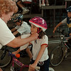 98/05/26--bike rodeo--Takaaki Iwabu photo-- Cristin Kozlowski, 6, gets her helmet adjusted by Jan Wellsby, coordinator of Niagara Athletic League Bike Rodeo Tuesday at Niagara Falls Civic and Convention Center.