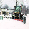 1/13/97 Snow Cleanup - James Neiss Photo - Hugh Gee, Operating Engineer for the City operates a Payloader to clean up drifting snow on Caravelle here, and other bad areas in the city.