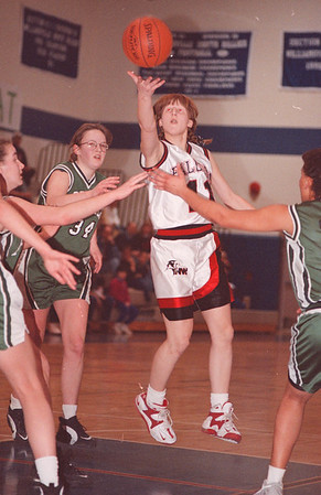 2/22/97-- falcons 1--Takaaki Iwabu photo-- Lady Falcons .............. (11) delivers a layup shot over the ....................... defenders. <br /> <br /> sports, Sunday, color