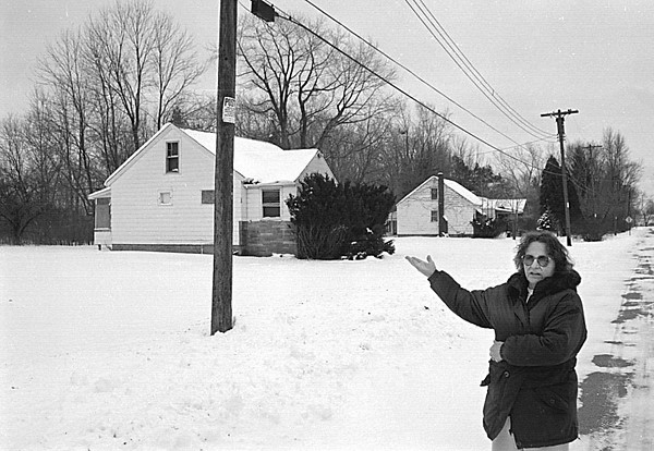 1/13/97 103rd Street - James Neiss Photo - Drena Morgan of 486 103rd Street shows the area that a local developer is interested in. Said she objects to the destruction of the wood land.
