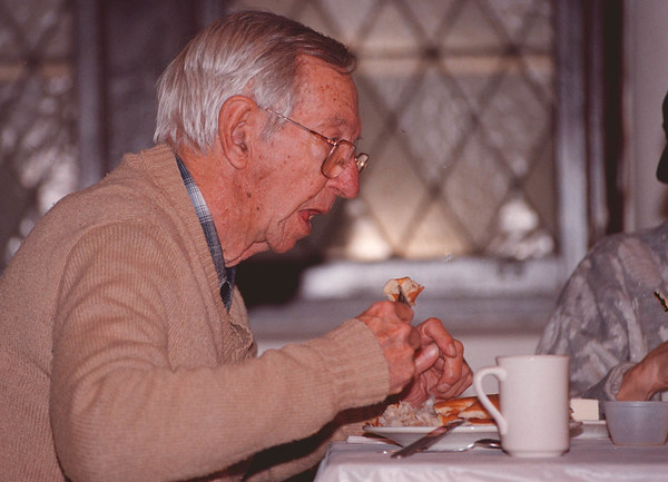 2/11/97--PANCAKE/FAT TUESDAY--DAN CAPPELLAZZO PHOTO--DON AMES, OF YOUNGSTOWN, DIGS IN TO HIS PANCAKE DINNER AT ST PETER'S CHURCH, 2ND AND RAINBOW, DURING A FAT TUESDAY CELEBRATION