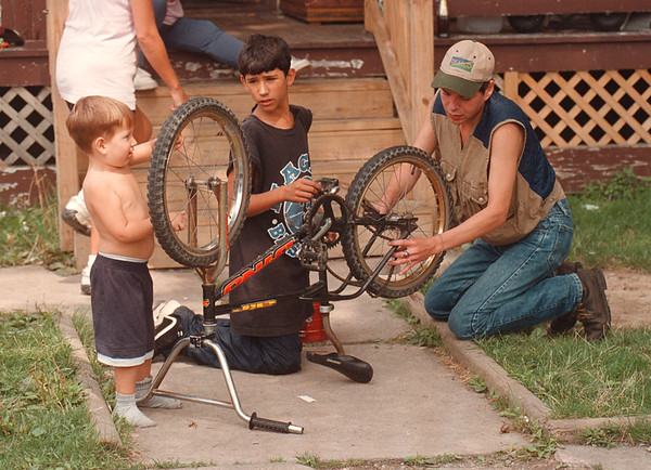 97/08/27 Bike Repair - James Neiss Photo - L-R- Little Frankie Nowak 3yrs, was helping his cousin Sean Strzelczyk 11yrs and friend Mike Chew fix a bike in front of Sean's Michigan Ave. home.