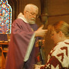 98/02/25-- Ash Wednesday --Takaaki Iwabu photo-- Father Guy Peek of St. Peter's Episcopal Church applies ashes to the Church members during the Ash Wednesday service at 140 Rainbow Blvd. <br /> <br /> local, Thursday, bw