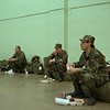 98/01/09 National Guard 2*Dennis Stierer photo - Sgt. Thomas Grabowski (far right, foreground) enjoys some lunch before he and his fellow gaurdsmen depart for Jefferson County to help flood victims. In the background are from left: Spec. Kevin Schendel, E-2 Brock Forsyth, and Spec. Kevin Curtis.