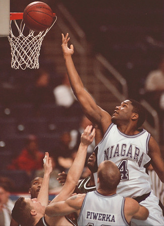 98/01/19-- NU basket1--Takaaki Iwabu photo-- Niagara University Jermaine Young goes up to the basket as he scores against Loyola College Monday at Marine Midland Arena. <br /> <br /> sports, color, tuesday
