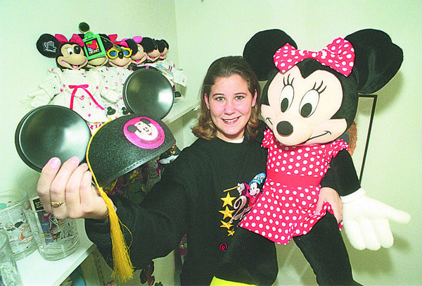 1/8/97 Amie Page - James Neiss Photo - Amie Page shows off her some of her Disney Collectables after returning as a intern from Disney in Florida.