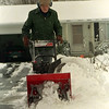 98/03/14 Winter Returns *Dennis Stierer photo - Edwin Thomas of Akron St. cleans his driveway as winter made a return this weekend.