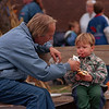"98/10/03 Special Time *Dennis Stierer Photo -<br /> ""Dann"" Townsend, from Appleton,enjoys spending some quality time with his grandson, Andy Swift, 2 as he helps him with his milk while taking a break at the recently held ""Hayday"" at NCCC."