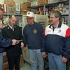 98/12/10 uaw/salvation soup--dan cappellazzo photo--(ltor)Uaw unit 1 pres dave kagels gives charlie foster a $1000 check for the soup kitchen as fellow unit one memebers help out: chiar of vets comm. art braunscheidel and unit 1 shop chair tim LaPort.