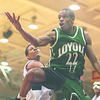 1/18/97-- NU basket 1 --takaaki iwabu photo-- Loyola's Anthony Smith and NU Hassan Abdullah fight for the loose ball under Loyola's basket.
