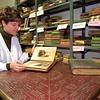 98/12/11 Historical Artifacts *Dennis Stierer Photo <br /> Vicki Harris, Deputy Town Clerk, looks over some of the many artifacts that are stored in the Hartland Town Hall basement room, which is called the the Town of Hartland Historical Society Museum.