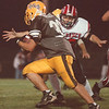 97/10/03-- HS football--Takaaki Iwabu photo-- LaSalle Explorers Jim Wilgosz (32) tries to go around the Clarense HS defender during the Friday's game.