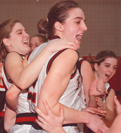 3/1/97--  NW Falcons--Takaaki Iwabu photo-- Niagara-Wheatfield HS basketball team celebrates as they won the Saturday's championship game. In the picture, Christy Eisenbart, left, and Chrissy Milleville. <br /> <br /> 1A, Sunday