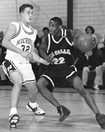 1/10/96-- HS hoops 2--Tak photo-- LaSalle's Carsmon Binger (22) dribbles into the baseline against Nichols Greg Barton.