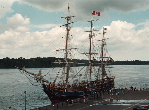 7/3/97 HMS Bounty 4 - James Neiss Photo - the HMS Bounty, A tall Sailing ship, visits Lewiston for weekend. Deckhands dock boat  and lower gang plank at Lewiston Waterfront.