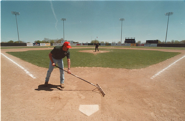 5/23/97 Shared Services - James Neiss Photo - Sal Maglie Stadium - Arthur Curcione, Front and Steve Juzwicki, back ground, both maintenance workers, Stadium Staff and 2 others maintain the cities apx. 26 ball diamonds.