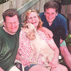 7/11/97- The Langes --Takaaki Iwabu photo-- The Langes, from left, Adam, Cathy and Scott share a laugh as their pet Eddy licks Adam's face. (Cathy, a single mother, raised two boys who are in colleges now --refer Judy's story.)<br /> <br /> feature, bw, Wednesday