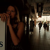 98/05/22-- factory mall --Takaaki Iwabu photo-- Tricia Strenkoski, an employee at Mad Hatter in Niagara International Factory Outlet, waits for the Mall's light comes up Friday when the power failed and cuased an hour inconvenience for the shoppers.