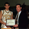 98/02/27-- award --Takaaki Iwabu photo-- Charlie Croff, left, received the recognition of McDonald's All American High School Basketball Team from the Lockport High School's Athletic Director Pat Burke. <br /> <br /> photobin, bw