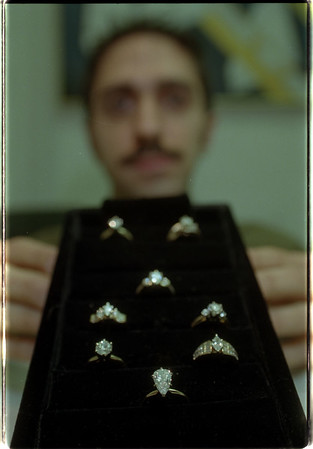 97/01/09 Firth Jewlers 2 - James Neiss Photo - Tom Laurrie, Managaer of Firth Jewlers, shows off Engagement Rings.