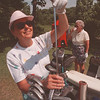6/16/97 Golf Story 2 - James Neiss Photo - Joan Reynolds of NF puts her club away as Nancy Marshanke of NF has a drink of water before moving onto the 5th hole at the Hyde Park Golf Course.