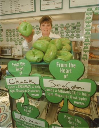 98/03/16 Green Bagel's - James Neiss Photo - The Green Bagel's are in at the Factory Outlet Mall Manhattan Bagel. Assistant Manager, Cindy Adamczyk shows off a tray full.  There would be plenty on hand through march 17th.