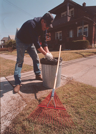 4/2/97 Spring Cleaning - James Neiss Photo - Jerry Palumbo of Grand Ave. cleans up his front yard, taking advantage of todays nice weather.