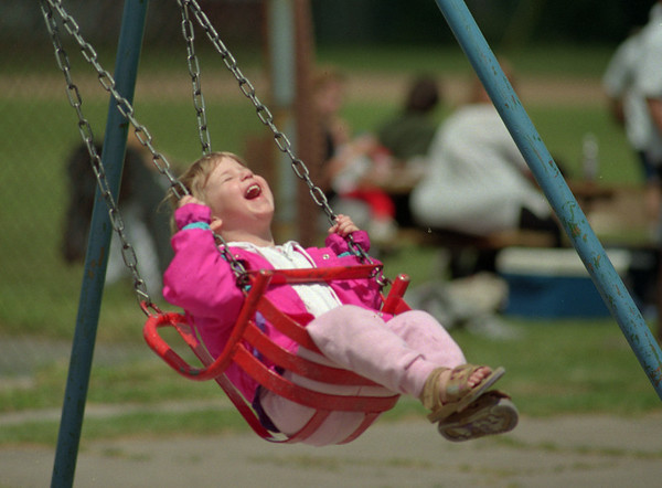 98/06/05 Great Swing *Dennis Stierer Photo - Three year old Jolene Hirner loves to swing and go high. She was have the laugh of a lifetime on Saturday at Willow Park.