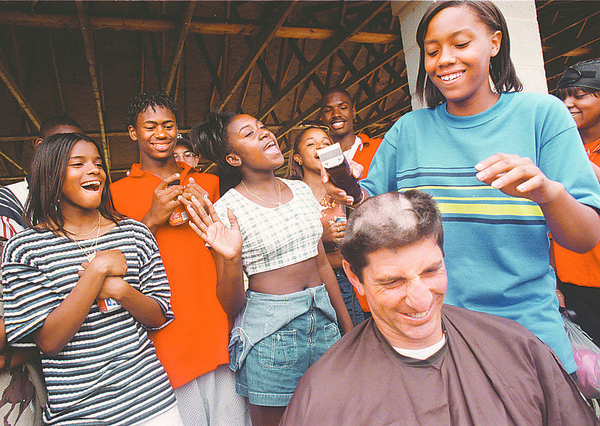 6/12/97-- shaving --Takaaki Iwabu Photo --A 9th grader Faith Thompson of Niagara Falls High School's track team shave her coach Sam Giancole's hair as other team members cheer during the team's annual party at Hyde Park Thursday. Thompson broke the School record (on shot put ? ) by 36. 50. and Thomson kept his promise on letting the student cut his hair. <br /> <br /> Sports, Friday