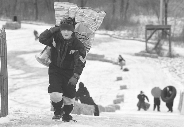 1/23/97 -- snowfestvial --Takaaki Iwabu photo-- Michael Brylinski braves the cold wind on the hill as he enjoys sledding at Bonds Lake Saturday during the Snow Fesvial. <br /> <br /> grapevine photo