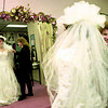 1/9/97--WEDDING--CAPPY PHOTO--TRACEY BILSON, OF N.F., TRIES ON A WEDDING DREWSS WITH THE HELP OF ALWAYS A BRIDESMAID OWNER SHERRI MORGAN.<br /> <br /> ECHO-MIRROR