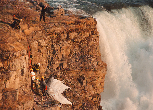 4/2/97--FALLS RESCUE--DAN CAPPELLAZZO PHOTO--NIAGARA FALLS FIRE DEPT. RESCUE TEAM PULL A WOMAN (IN WHITE ON GORGE WALL) UP FROM THE BRINK OF THE AMERICAN FALLS  AFTER AN APPARENT SUICIDE ATTEMPT.<br /> <br /> NEWS/1A