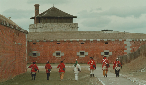 98/1/2 Old Fort Niagara - Vino Wong Photo - Re-enactors pose as British Soldiers living in the 18th Century march towards The North Redoubt at the Old Fort Niagara Saturday.