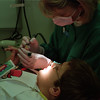 98/11/06 Tickle Tool *Dennis Stierer Photo -<br /> Chris Hickman, Hygienist with Dr. Louis A. Surace, a pediatric dentist in Lockport calls her cleaning, spinning brush the 'tickle tool' as it just tickles you clean as she shows patient Adam Mault, 10 how it feels on his finger.