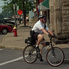 98/08/14--BIKE POLICE--DAN CAPELLAZZO PHOTO--MEDINA OFFICER CHRIS SCHICKER RIDE THE POLICE MTN. BIKE OFF MAIN ST.<br /> <br /> ME