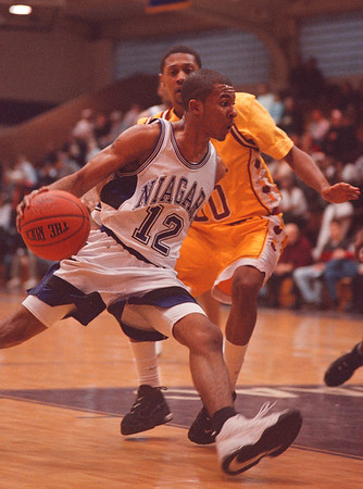 2/2/97-- NU hoops 2-- tak photo-- NU J. Johnson takes a step toward the hoop during Sunday's game with Iona.