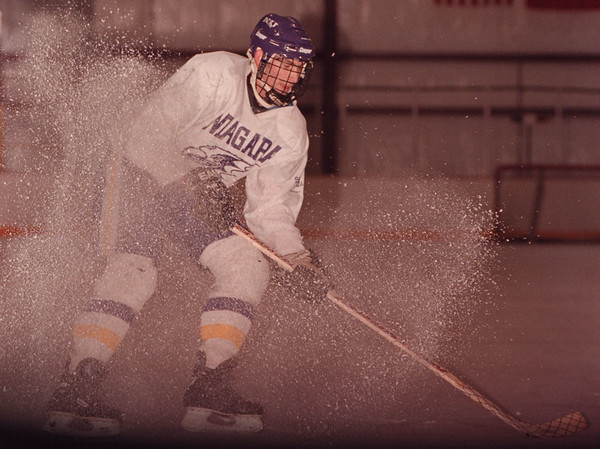 97/11/20--NU HOCKEY--DAN CAPPELLAZZO PHOTO--NU SOPHOMORE AJ MELANSON PUTS ON THE BRAKES DURING A DRILL AT NU PRACTICE. MELANSON IS RETURNING FROM INJURY AND HOPES TO PLAY AGAINST CORNELL.<br /> <br /> SP