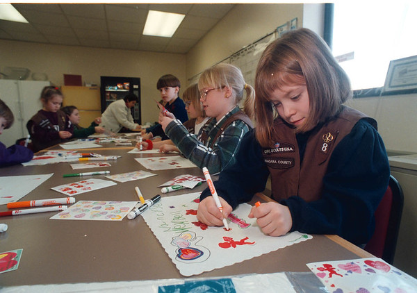 1/28/97 Place Mats for Seniors - James Neiss Photo - Nancy Seiwell 6yrs, a member of Brownie Troop 8 works on a Valentines place mat for a senior citizen.<br /> Colonial Village School<br /> Town of Niagara