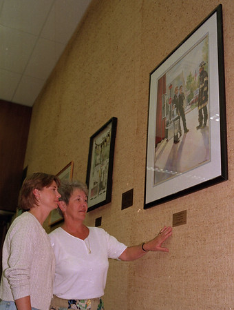 98/05/06 New Artwork at City Hall *Dennis Stierer Photo - Patti Starr and Helen Paulsen stapped at Council Chambers Wednesday night to see the new artwork that was donated by local artists.