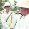 98/04/01 Olcott Vistors *Dennis Stierer photo - Richard Liu, left the 'Interpretor' listens to the group leader 'Teacher' Chen. The group was in Olcott, NY today.