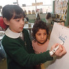 4/18/97 Spelling Bee Winner - James Neiss Photo - Cristina deRosa (correct spelling) 9yrs/3rd grade spells out one of the words she got correct to win 4th place in a state wide spelling Bee., Her reading buddy Teasha Hasely 5yrs/KG looks on.<br /> Prince of Peace School.