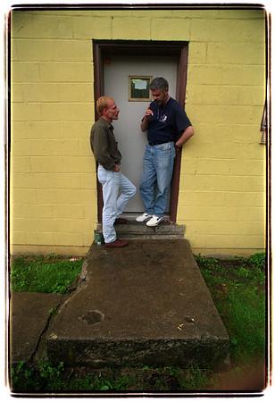 6/18/97 Clubhouse Niagara - James Neiss Photo - Orientation Outreach Supervisor Tom Salada chats with client Ilia Nemirovski of NF, wile he takes a smoke break.