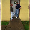 6/18/97 Clubhouse Niagara - James Neiss Photo - Orientation Outreach Supervisor Tom Salada chats with client Ilia Nemirovski of NF, wile he takes a smoke break.