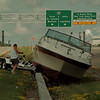98/07/31 Boat Accident - James Neiss Photo - This unhappy boat owner, a NF undercover cop who asked not to be identified, calls in his boat accident just after it happed on the LaSalle Expressway. He said the cause of the accident was the two bumps and dip in the expressway that has plagued moterists for years. He said he was driveng apx 50 mph when he hit the bumps and everything let loose. He said thank god there was no injuries, but the boat sufferd some bad damage.
