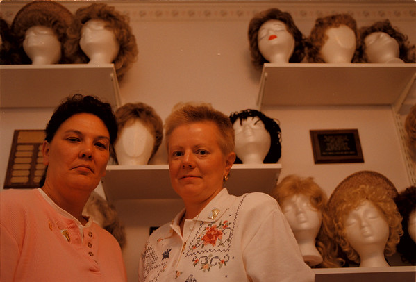 98/10/02 Cancer Wigs - Vino Wong Photo - (L to R) Janaa Goodman and Lucy Burger stand among the wigs they have at the American Cancer Society.