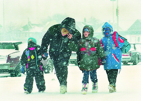 1/9/97--WEATHER--CAPPY PHOTO--LAURA CARTER, OF NF, WALKS HER HEPHEWS AND NIECE, (LTOR) MICHEAL STERZINGER, KATHLEEN STERZINGER AND JOSEPH STERZINGER HOME FROM SCHOOL,ACROSS TOPS PARKING LOT, PORTAGE RD THURSDAY AFTERNOON FDURING THE HIEGHT OF THE SNOW.<br /> <br /> 1A