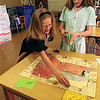 98/05/19 Math Canal-Rachel Naber Photo-Elizabeth Roberts (left) plays Math Canal a game invented by Catlin miller a fourth grader at Oak Orchard Elementary.