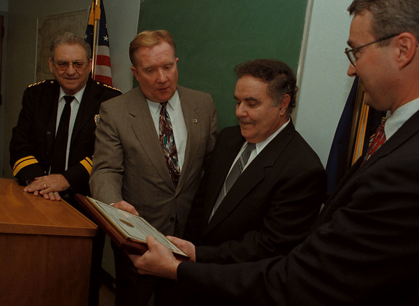 97/11/06--FBI AWARD--DAN CAPPELLAZZO PHOT0--VINCE SPADORCIA (2ND FROM LEFT) RERCIEVES THE FBI DIRECTORS AWARD FROM FBI RES. AGENT BILL O'CONNOR AS MAYOR JAMES GALIE AND NF POLICE CHIEF ANTHONY C. FERA AT POLICE HEADQUARTERS.<br /> <br /> LOCAL