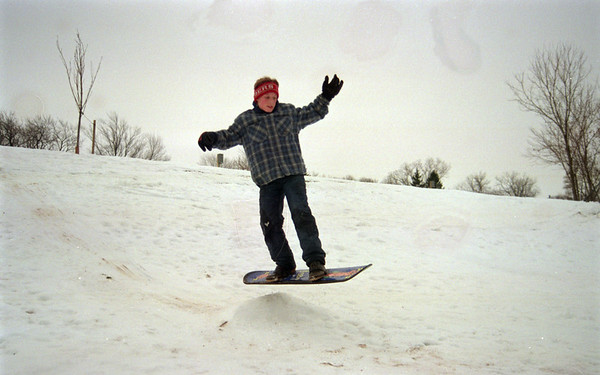 98/1/27 Snowb ENT.-Rachel Naber Photo-Matt Mundion a 7th grader from RoyHart Middle School takes a break from studying for exams and catches some air on the only hill in town.